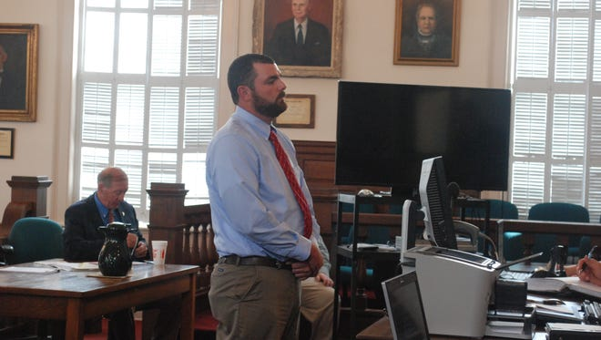 North Augusta police officer Justin Craven stands during his hearing Monday, April 11, 2016, at the Edgefield County courthouse in South Carolina. Craven, who was charged with a felony for shooting and killing a black driver at the end of a chase took, a plea deal Monday and was sentenced to three years of probation. (Maayan Schechter/The Aiken Standard via AP) MANDATORY CREDIT