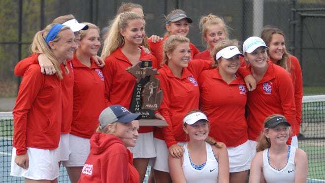 St. Clair's girls tennis team poses for a photo after winning the Division 3 regional title at Sanborn Park.