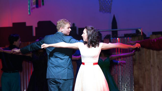 "Andrew Newton as Tony and Kate Welsh as Maria in CenterStage's production of ""West Side Story."""