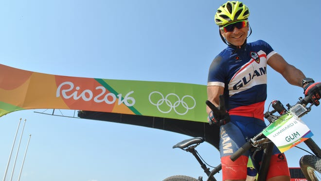 Peter Lombard is all smiles at the start line of the Mountain Bike Centre in Rio de Janeiro on Aug. 18.