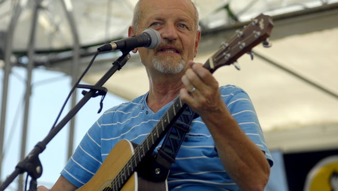 Emory Floyd performs a song at the 2015 BlueChiliGrass Festival.
