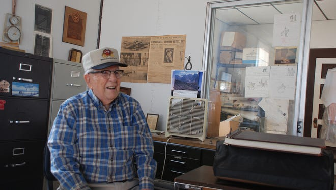 """Johnson Stearns (1917- 2015) best known as retired banker, wore """"many hats,"""" including real estate agent, hotel manager, and railroad buff. His knowledge of Carrizozo earned him the title 'historian' for his interest in his beloved hometown and county. He is shown sitting in his office, where he and I would have endless chats."""