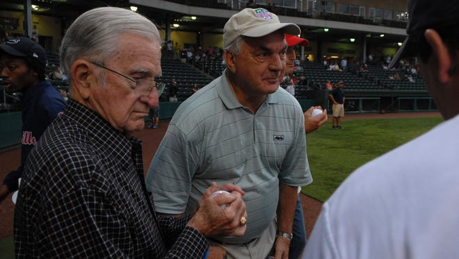 Former Easley High football coach Larry Bagwell, center, waits with  Bill Robinson to throw out a first pitch before the Greenville Drive take on the Augusta GreenJackets at Fluor Field on August 25, 2008.