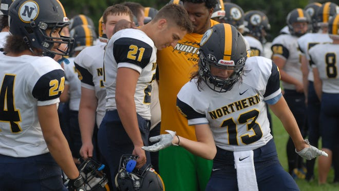 Noah McNutt (13) dances before kickoff of Port Huron Northern's 28-6 win over Center Line on Sept. 10, 2016.