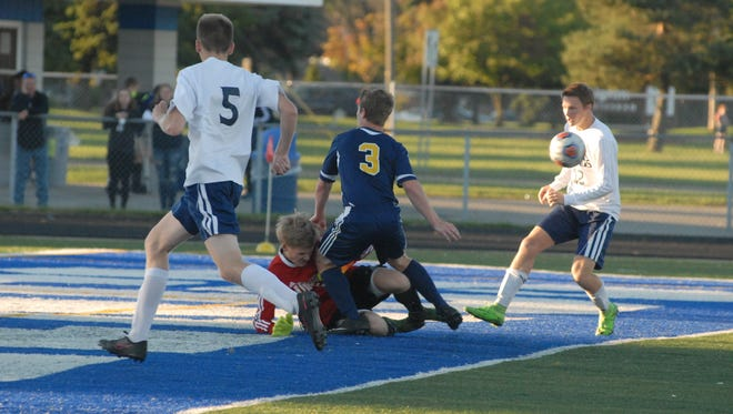 Port Huron Northern's Jeremy Sayers collides with Marysville goalkeeper Brett Robinson in the first half of the Vikings 2-1 win on Sept. 14, 2016.