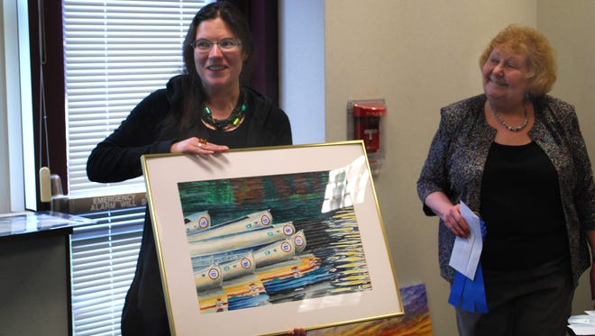 """Carrie """"Care"""" Wheeler, first-place winner of the art category for """"Canoes"""" during the fourth Three Cities Art Show, and club president Marilyn Meredith."""