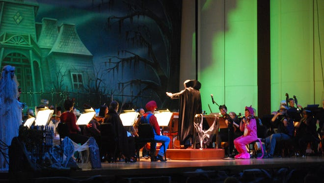 Alfred Savia conducting the Evansville Philharmonic Orchestra during the Halloween Bash.
