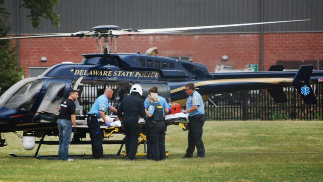 A State Police helicopter stands by to airlift a victim to Christiana Hospital after a July 8, 2012, shooting at Eden Park.