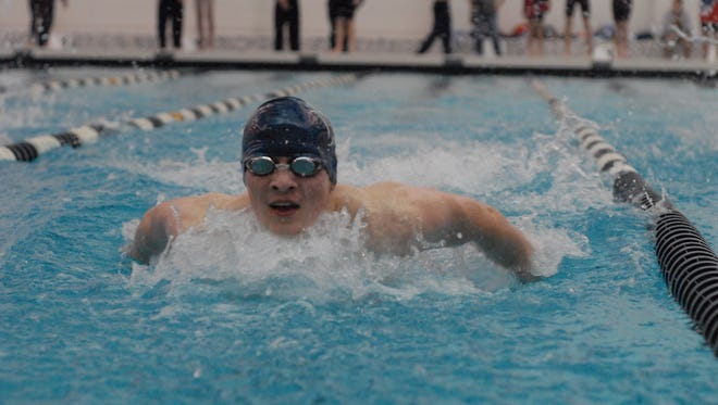 Marysville's Jeremy Latham finishes his butterfly during the 200 IM against Cousino on Jan. 18, 2017.