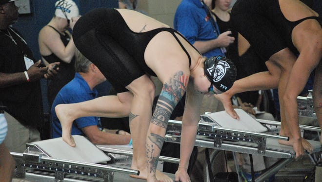 UWF's star swimmer Theresa Michalak gets set for the start of the women's 100 breaststroke where she set a new NCAA Division II record and won her third national title.