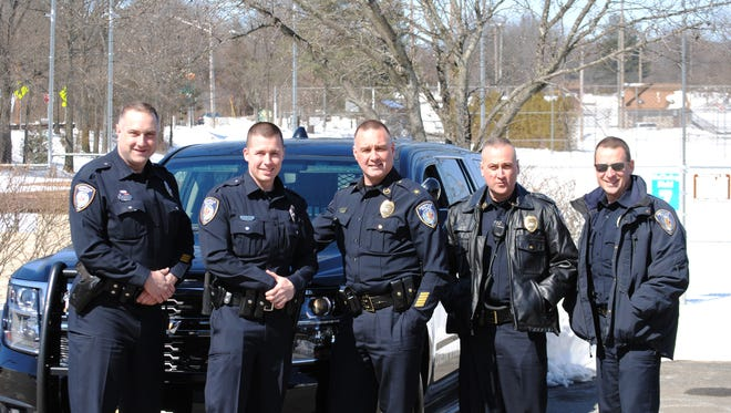 Denville Police Officer Richard Duda , Officer Douglas Large, Chief Christopher Wagner, Captain Paul Nigro and Officer William Underwood pose for a group photo after taking their portraits for their trading cards.