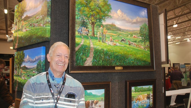 Artist Larry Schultz was commissioned to paint a picture commemorating the 25th anniversary of the Professional Dairy Producers of Wisconsin. The original oil painting was auctioned during the group's business conference last week. The artist here posed with the work during the conference's trade show.