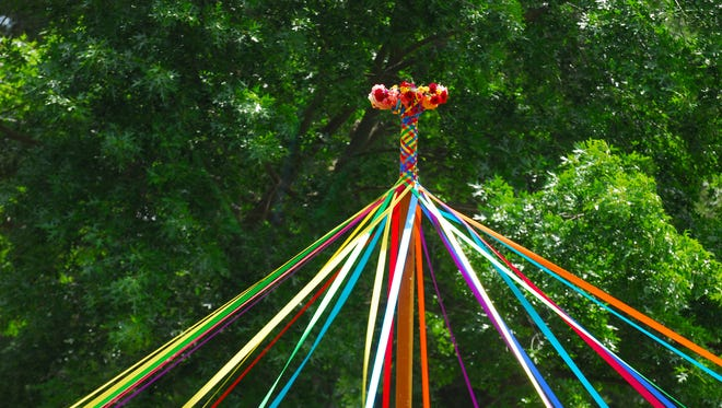A maypole is part of a traditional spring May Day celebration.