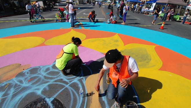 Volunteers help artists from Urban Arts Collaborative paint a huge mandala. Sunday, October 25th saw a great turnout for the third annual Ciclovia Salinas, where a long section of Alisal Street was closed to motor traffic for four hours, allowing hundreds of citizens to enjoy a car-free day.