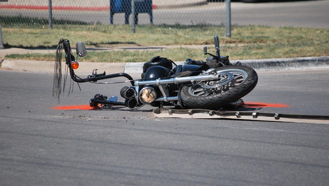 A motorcycle lays on its side after a collision at the 900 Block of Main Street, June 15, 2017