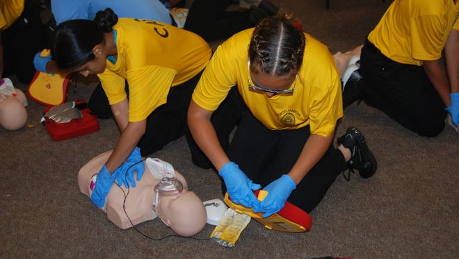 Perth Amboy Police Department Youth Academy practicing CPR.