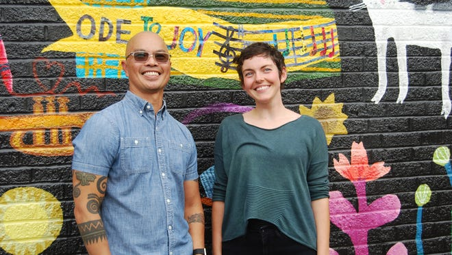 Local artists John Lanzador, left, and Lizzy DuQuette worked with ArtWorks to create murals along Warsaw Avenue in Price Hill. Sept. 12, 2017
