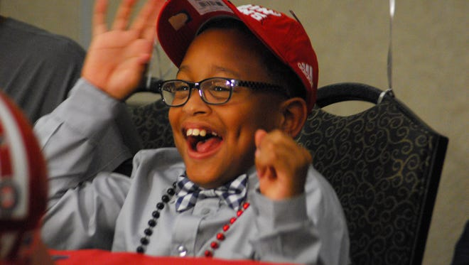 Tay'Shawn Landry, 10, becomes an honorary Ragin' Cajun during a draft day ceremony Friday, Sept. 22 in Lafayette.  Tay'Shawn was diagnosed with cerebral palsy in 2007.  The event was made possible through Team IMPACT, a nonprofit that aims to improve the quality of life for children with chronic illnesses.