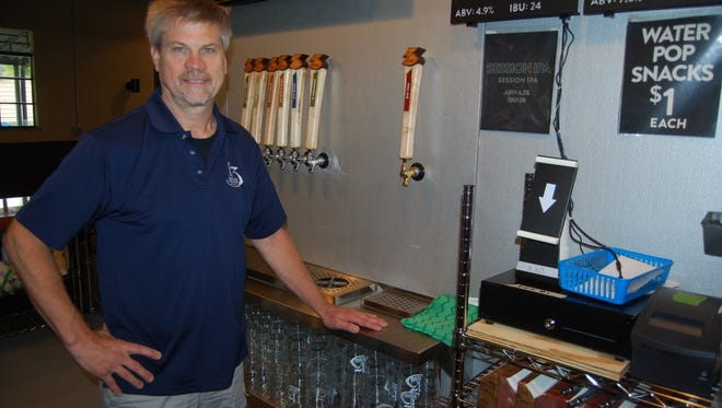 Doug Menkedick is a co-owner of 13 Below Brewery, which opened in Sayler Park in September. Oct. 12, 2017