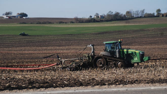 This time of year one of the big projects for farmers or for hired manure applicators is to get that liquid manure spread on the open corn and soybean fields. Here an applicator uses a dragline to spread and inject manure.