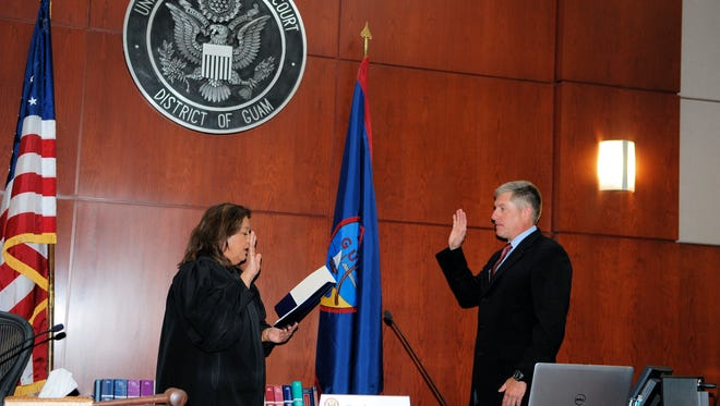 Chief Judge Frances Tydingco-Gatewood, left, swears in Shawn N. Anderson to serve as interim United States Attorney for the Districts of Guam and the Northern Mariana at the District Court of Guam in Hagåtña on Jan. 4, 2018. Anderson was appointed by U.S. Attorney General Jeff Sessions to serve for 120 days or until a Presidential appointee qualifies.
