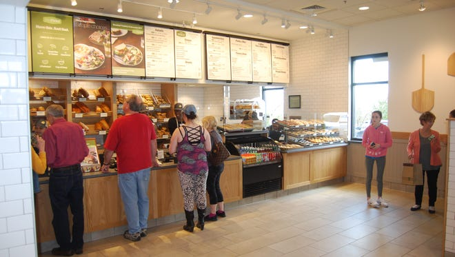 Customers place their orders at the new Panera Bread in Green Township. The bakery/cafe had its grand opening April 3, 2018.