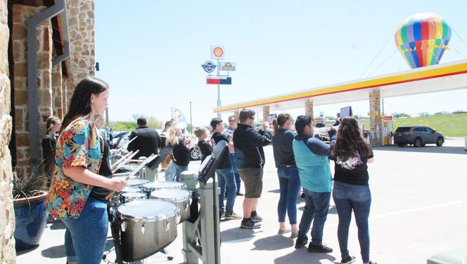 The Henrietta High School Band joined members of the Henrietta & Clay County Chamber of Commerce with representatives from Victron Energy in officially opening the Texas Best Smokehouse travel center off U.S. 287. Victron Energ is the owner of the travel center.