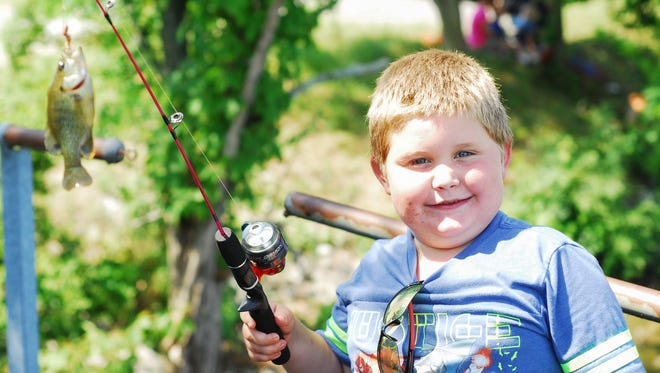 Jeff Fishburn with his big catch during the Kids Fishing Derby at Lock 4 Point Park in Gallatin on Saturday, June 9.