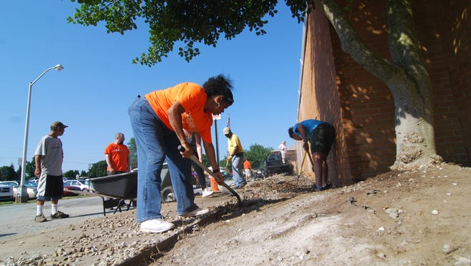 Members of a local church and other community members helped remodel Christina Early Education Center Saturday morning.