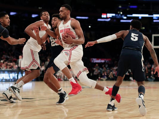 Ohio State forward Keita Bates-Diop, center, drives to the basket against Penn State during the first half of an NCAA Big Ten Conference tournament college basketball game, Friday, March 2, 2018, in New York. (AP Photo/Julie Jacobson)