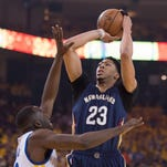 Pelicans forward Anthony Davis takes a shot over Golden State's Draymond Green during last season's NBA playoffs.
