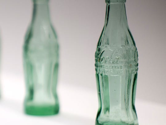 Coca-Cola bottles are displayed during a preview of