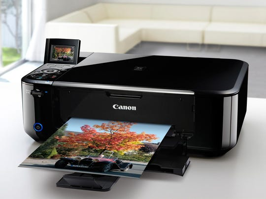 """An """"all-in-one"""" printer such as this model by Canon can scan, copy and fax as well."""