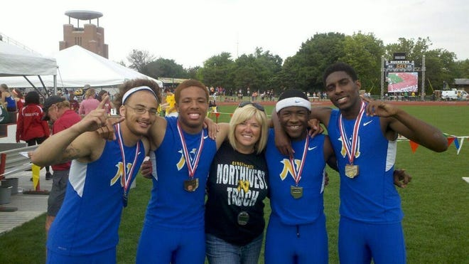 Celebrating their 2013 Division I state title victory in the 4x100 relay are, from left, Dominick Williams, Miles Baldwin, coach Lori Spence, DeVohn Jackson and Jamiel Trimble of Northwest High School. Their time of 41.28 was the third-fastest time in state history.