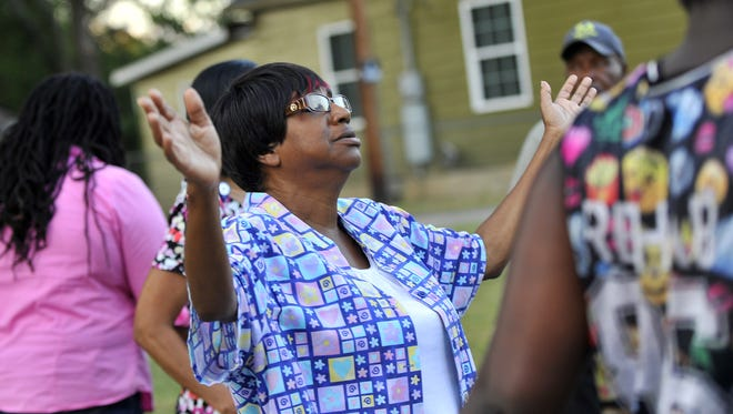 Members of the City View  Coalition held a prayer walk to reclaim their community. In November, the group plans to launch a new effort to increase residents' involvement.