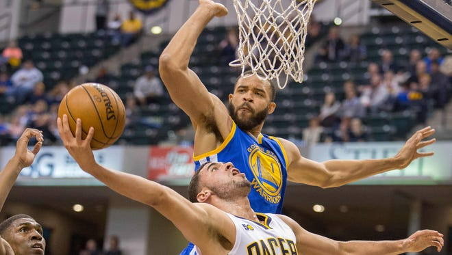 Nov 21, 2016; Indianapolis, IN, USA; Golden State Warriors center JaVale McGee (1) blocks the shot of Indiana Pacers forward Georges Niang (32) in the second half of the game at Bankers Life Fieldhouse. Golden State beat Indiana 120-83. Mandatory Credit: Trevor Ruszkowski-USA TODAY Sports