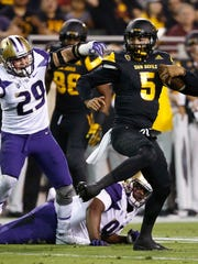 Arizona State quarterback Manny Wilkins (5) spins away from Washington linebacker Connor O'Brien (29) during the first half of an NCAA college football game, Saturday, Oct. 14, 2017, in Tempe, Ariz. (AP Photo/Ross D. Franklin)