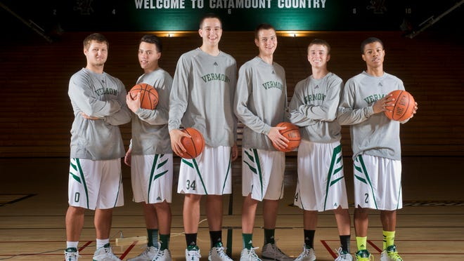 The six freshman on the University of Vermont men's basketball team gather for a portrait at Patrick Gymnasium. From left to right are Brandon Hatton, Ernie Duncan, Drew Urquhart, Zach McRoberts, Cam Ward and Trae Bell-Haynes — all of whom hail from outside the Northeast, ushering in a new trend of recruiting for the Catamounts.