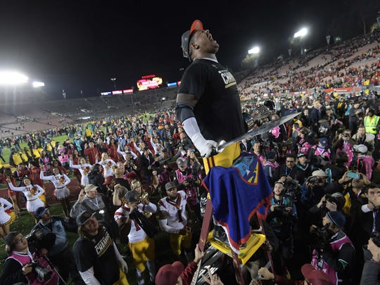 USC Trojans offensive tackle Zach Banner celebrates with the Spirit of Troy marching band after the 103rd Rose Bowl against the Penn State Nittany Lions at Rose Bowl.