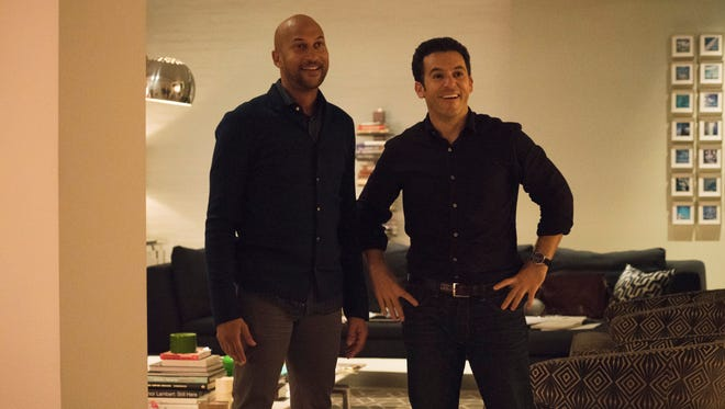 "Novelist Ethan (Keegan-Michael Key), left, and literary agent Max (Fred Savage) are longtime college buddies in Netflix's ""Friends from College."""