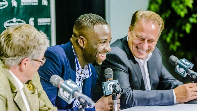 Former MSU basketball player Draymond Green, center, smiles as MSU hoops coach Tom Izzo, right, looks on, Sept. 10, 2015.