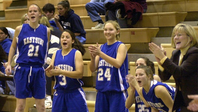 Eastside coach Cindy Mattos-DeHart and her players celebrate a big moment in the 2006 Lady Sandlapper Holiday Classic. The Eagles, runners-up that year, have won the tournament eight times.