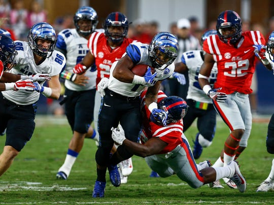 October 1, 2016 - University of Memphis return man Tony Pollard (middle) rushes against the Ole Miss cover team during acton at VaughtÐHemingway Stadium in Oxford, Miss.