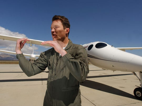 Pilot Mike Alsbury was killed in the Virgin SpaceShipTwo crash in Mojave Desert.  Mike Alsbury, a project engineer and pilot, gestures as he explains a potential midair collision scenario April 3, 2003 in Mojave, Calif.