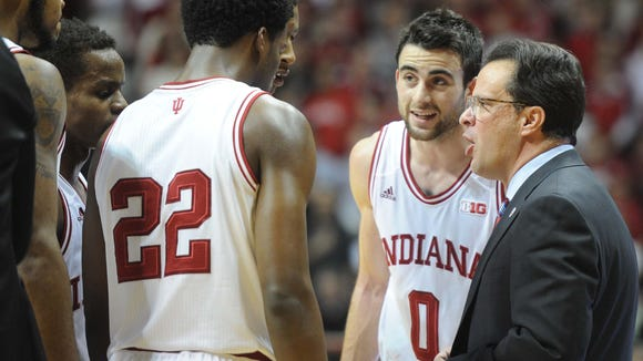 Tom Crean and Will Sheehey talk to the team during a timeout. Indiana University hosted Michigan State University in a Big Ten mens basketball game at Assembly Hall in Bloomington Saturday January 4, 2014. MSU won 73-56.