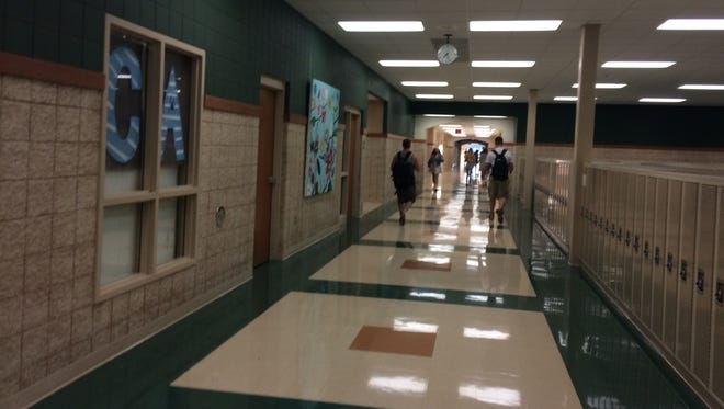 Students at Bay Port High School in Suamico head to class on Tuesday, the first day of school.