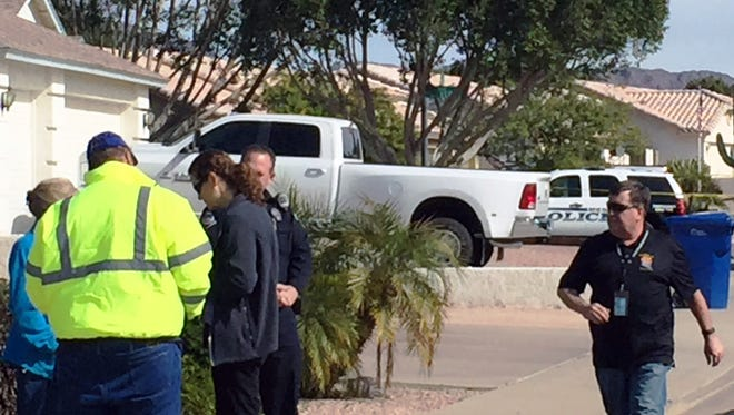 Police personnel respond Feb. 4, 2016, to a Mesa, Ariz., home where an officer shot a suicidal woman with Asperger's syndrome.