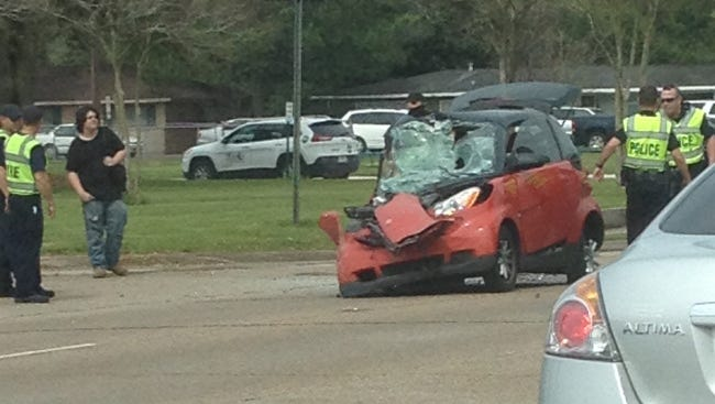 A car rear-ends a bus outside Lafayette High March 16