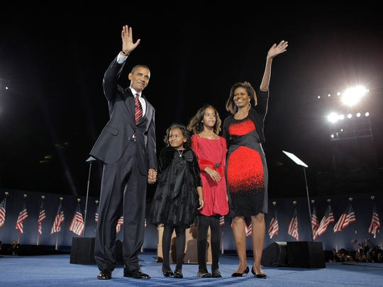 President Obama's legacy isn't Obamacare, Kevin Aldridge writes. Shown, Barack Obama, wife, Michelle, and their two daughters, Sasha and Malia, attend an Election Night rally in Chicago on Nov. 4, 2008.