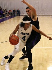 Mescalero's Alex Kaydahzinne tries to dribble past